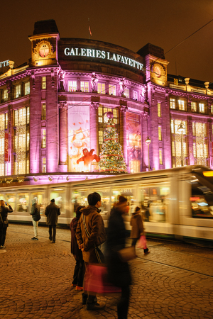 STRASBOURG, FRANCE - DEC 5, 2014: Galeries Lafayette luxury shopping mall in Strasbourg decorated for Christmas. Strasbourg is considered the most picturesque experience of Christmas spirit and one of the oldest Christmas Market in Europe attracting over