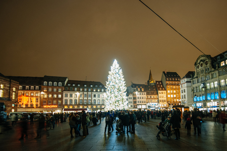 STRASBOURG, FRANCE - DEC 5, 2014: Strasbourg Christmas Tree erected in Place Kleber. Place Kleber Strasbourg is considered the most picturesque experience of Christmas spirit and one of the oldest Christmas Market in Europe attracting over 2 million visit