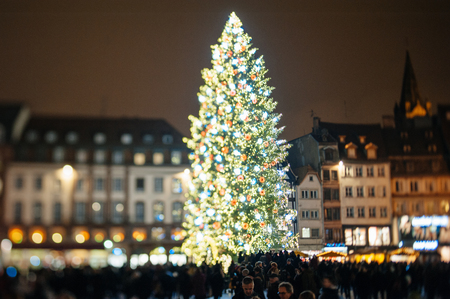 STRASBOURG, FRANCE - DEC 5, 2014: Strasbourg Christmas tree. Strasbourg is considered the most picturesque experience of Christmas spirit and one of the oldest Christmas Market in Europe attracting over 2 million visitors every year.