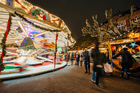 world market: STRASBOURG, FRANCE - DEC 5, 2014: Christmas carousel in Place Broglie, Strasbourg. Strasbourg is considered the most picturesque experience of Christmas spirit and one of the oldest Christmas Market in Europe attracting over 2 million visitors every year. Editorial