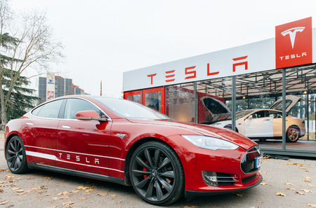 car dealer: PARIS, FRANCE - NOVEMBER 29: New Tesla Model S showroom has arrived in Paris, France. Tesla is an American company that designs, manufactures, and sells electric cars