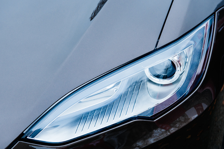 PARIS, FRANCE - NOVEMBER 29:  The Tesla Motors Inc. frontal view advanced xenon head-lights of the Model S electric vehicle displayed at the company