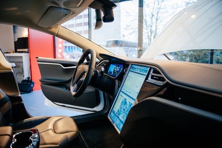 PARIS, FRANCE - NOVEMBER 29: The interior of a Tesla Motors Inc. Model S electric vehicle with its large touchscreen dashboard. Tesla is an American company that designs, manufactures, and sells electric cars Editoriali