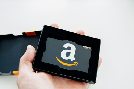 hand card: LONDON, UNITED KINGDOM - Amazon Gift Card in beautiful box ready to be offered as a gift. Amazon Gift Box with A greeting Card is delivered in one-day shipping through the world and is available to purchase million of products from the online retailer