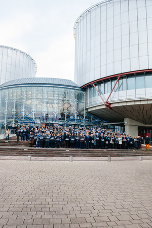 jurists: STRASBOURG, FRANCE - 8 JAN 2015: European Court of Human Rights President Dean Spielmann and Registrar Erik Fribergh, Judges and jurists observe a minute of silence in Strasbourg for the victims of an attack by armed gunmen on the offices of French satiri Editorial
