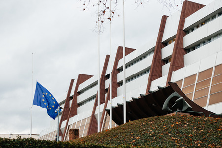 satirical: The European Union Flag flies at half-mast in front of the Counci of Europe on January 8, 2015 following an attack the day before against French satirical weekly newspaper Charlie Hebdo offices in Paris which left 12 people dead Editorial