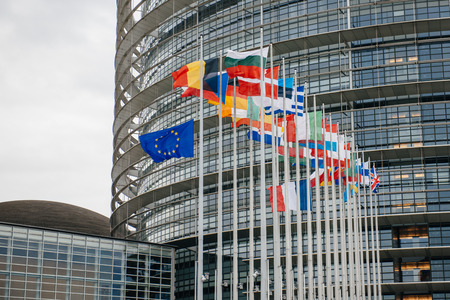 satirical: The French and European Union Flag flies at half-mast in front of the European Parliament in Strasbourg on January 8, 2015 following an attack the day before against French satirical weekly newspaper Charlie Hebdo offices in Paris which left 12 people dea