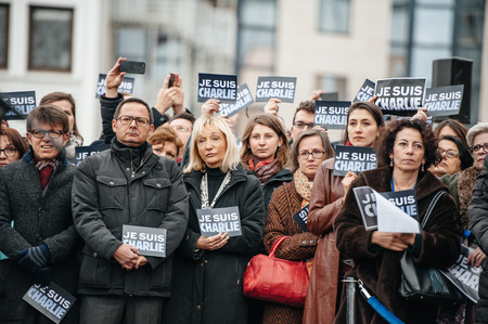 satirical: STRASBOURG, FRANCE - JANUARY 09, 2015: Council of Europe employees and Thorbjorn Jagland - Secretary General of the CE attend to a silent vigil to condemn the gun attack at French satirical magazine Charlie Hebdo office in Paris, which killed 12 people on