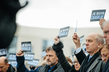 vigil: STRASBOURG, FRANCE - JANUARY 09, 2015: Council of Europe employees and Thorbjorn Jagland - Secretary General of the CE attend to a silent vigil to condemn the gun attack at French satirical magazine Charlie Hebdo office in Paris, which killed 12 people on