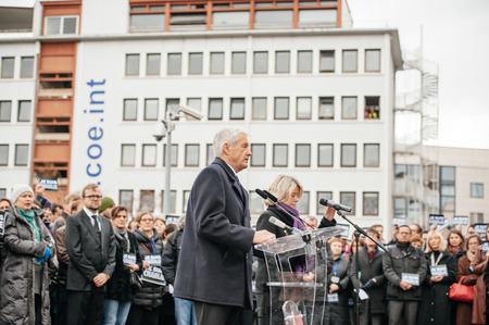 satirical: STRASBOURG, FRANCE - JANUARY 09, 2015: Thorbjorn Jagland - Secretary General of the Council of Europe and COE employees attend to a silent vigil to condemn the gun attack at French satirical magazine Charlie Hebdo office in Paris, which killed 12 people o