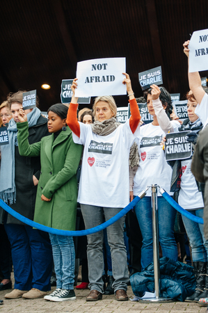 shootings: STRASBOURG, FRANCE - JANUARY 09, 2015: Council of Europe employees and Thorbjorn Jagland - Secretary General of the CE attend to a silent vigil to condemn the gun attack at French satirical magazine Charlie Hebdo office in Paris, which killed 12 people on