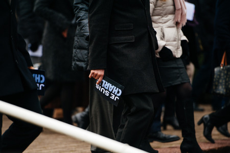 STRASBOURG, FRANCE - JANUARY 09, 2015: Man holding Je Suis Charlie poster after attending a silent vigil to condemn the gun attack at French satirical magazine Charlie Hebdo office in Paris, which killed 12 people on January 7, 2015