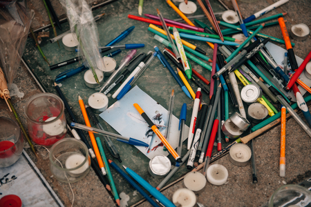 shootings: STRASBOURG, FRANCE - 10 JAN, 2015: Light candles and pencils near General Kleber statue in tribute to the victims of the terrorist attacks in Paris on January 11, 2015