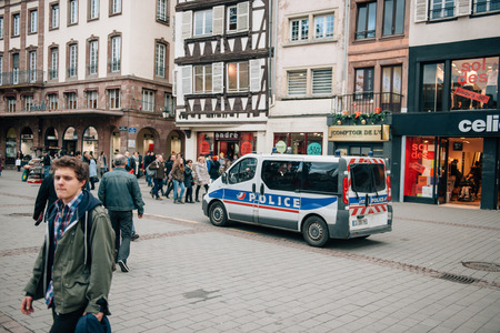 shootings: STRASBOURG, FRANCE - 10 JAN, 2015: Police van monitoring the center of Strasbourg after the terrorist attacks in Paris on January 11, 2015