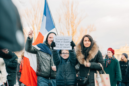 STRASBOURG, FRANCE - 11 JAN, 2015:  People hold placards reading They wanated to kill a magazine, they are killed in a typography during a unity rally (Marche Republicaine) where some 50000 people took part in tribute three-day killing spree in Paris Editorial