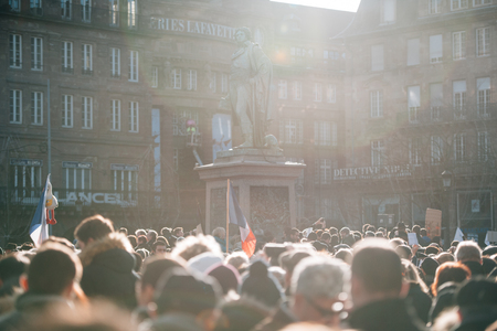 shootings: STRASBOURG, FRANCE - 11 JAN, 2015:  Poeple gather near GEneral Kleber statue for a unity rally (Marche Republicaine) in tribute three-day killing spree in Paris Editorial
