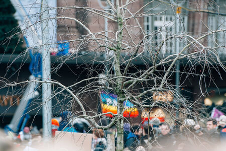 STRASBOURG, FRANCE - 11 JAN, 2015:  Gay flag seen through a tree during a unity rally (Marche Republicaine) where some 50000 people took part in tribute three-day killing spree in Paris