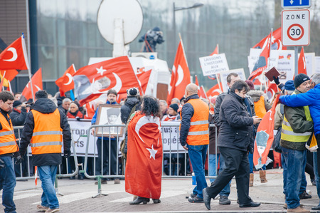 the case before: STRASBOURG, FRANCE - 28 JAN 2015 Woman wearing Turkey flag while diaspora protests at European Court of HR before the Perincek vs. Switzerland case begin. Armenian government was represented by Amal Clooney