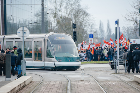 the case before: STRASBOURG, FRANCE - 28 JAN 2015 Tram passing near Turkey diaspora demonstating at European Court of HR before the Perincek vs. Switzerland case begin. Armenian government was represented by Amal Clooney