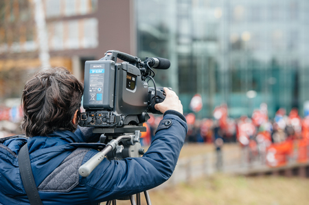 the case before: STRASBOURG, FRANCE - 28 JAN 2015 Cameraman filming Turkey diaspora near European Court of HR before the Perincek vs. Switzerland case begin. Armenian government was represented by Amal Clooney Editorial