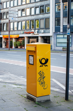 bundespost: BREMEN, GERMANY - 03 JUNE: Yellow German Post (Deutsche Post DH) box on street in Bremen, Germany on June 03, 2010. Deutsche Post DHL, is the worlds largest courier company