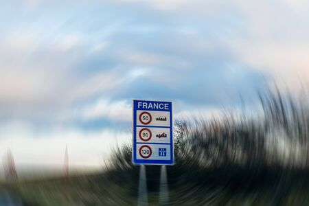 kmh: Entrance to France with speed limitation sign - 50kmh inthe city, 90 kmh outside the city and 130 on the highway Stock Photo