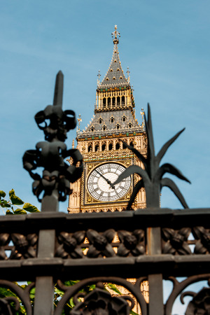 London, Big Ben seen throu a decorative fence on a sunny summer day photo