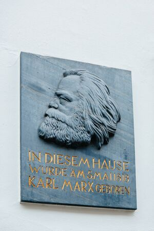 sociologist: TRIER, GERMANY - FEB 21, 2015: Commemorative plaque at the house were Karl Marx, the German philosopher, economist, sociologist, journalist, and revolutionary socialist was born in 1818