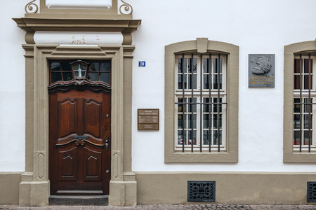 sociologist: TRIER, GERMANY - FEB 21, 2015: Commemorative plaque on the facade of the house were Karl Marx, the German philosopher, economist, sociologist, journalist, and revolutionary socialist was born in 1818