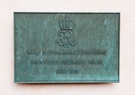 quartered: TRIER, GERMANY - 22 FEB, 2015: Koniglich Preussische Rheinisches, Infanterie Regiment 69 commemorative plaque on the Kurfurstliches Palais - Electoral Place in Trier, Germany. Since 1871, the Rheinische 7th Infantry Regiment Nr. 69 was quartered in the sa