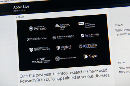 keynote: PARIS, FRANCE - MAR 9, 2015: Apple Computers event keynote tweets close up seen on iMac with talented researchers using REsearchKit to build apps for serious diseases as seen on 9 March, 2015