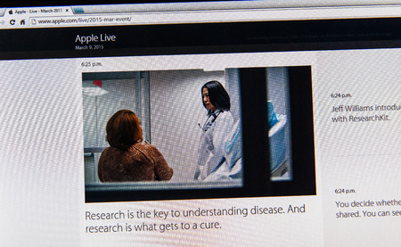 keynote: PARIS, FRANCE - MAR 9, 2015: Apple Computers event keynote tweets close up seen on iMac with the importance of research and cure as seen on 9 March, 2015