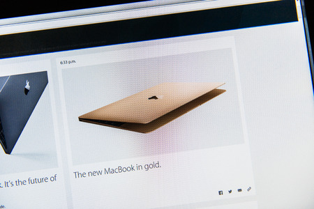 keynote: PARIS, FRANCE - MAR 9, 2015: Apple Computers event keynote tweets close up seen on iMac with the announcement of the new MacBook in Gold - the thinnest and lightest form ever with Retina display seen as the future of notebook as seen on 9 March, 2015