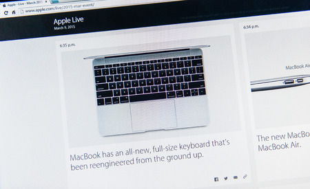 keynote: PARIS, FRANCE - MAR 9, 2015: Apple Computers event keynote tweets close up seen on iMac with the newly launched  MacBook featuring full-size keyboard reengineered from the ground as seen on 9 March, 2015 Editorial