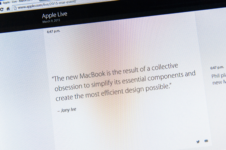 PARIS, FRANCE - MAR 9, 2015: Apple Computers event keynote tweets close up seen on iMac with the quote of Jony Ive about new MacBook design as seen on 9 March, 2015