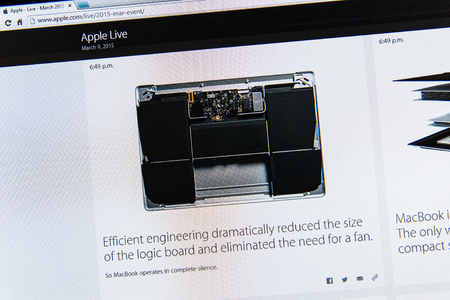 tweets: PARIS, FRANCE - MAR 9, 2015: Apple Computers event keynote tweets close up seen on iMac with the newly launched MacBook and its innovative logic board without a fan as seen on 9 March, 2015