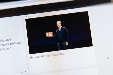 tweets: PARIS, FRANCE - MAR 9, 2015: Apple Computers event keynote tweets close up seen on iMac with the newly MacBook in the hands of Tim Cook as seen on 9 March, 2015 Editorial