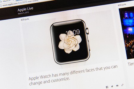 keynote: PARIS, FRANCE - MAR 9, 2015: Apple Computers event keynote tweets close up seen on iMac display featuring many faces of Apple Watch to customize as seen on 9 March, 2015