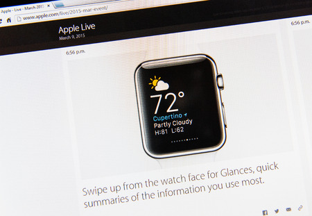 PARIS, FRANCE - MAR 9, 2015: Apple Computers event keynote tweets close up seen on iMac display with weather and other information user uses most as seen on 9 March, 2015