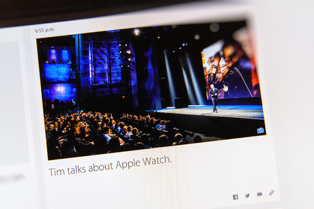 PARIS, FRANCE - MAR 9, 2015: Apple Computers event keynote tweets close up seen on iMac display with Tim Cook talks about Apple Watch as seen on 9 March, 2015