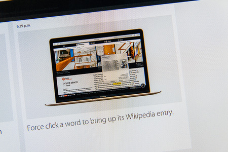 wikipedia: PARIS, FRANCE - MAR 9, 2015: Apple Computers event keynote tweets close up seen on iMac with the force click a word to bring up its Wikipedia entry as seen on 9 March, 2015 Editorial
