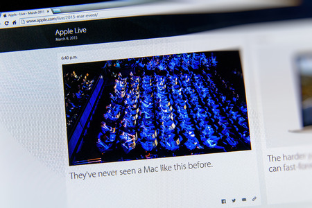 keynote: PARIS, FRANCE - MAR 9, 2015: Apple Computers event keynote tweets close up seen on iMac with a photograph featuring audience at the Apple Keynote as seen on 9 March, 2015
