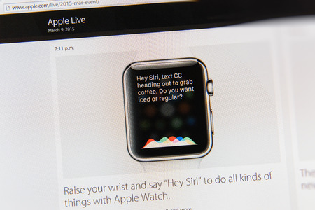 tweets: PARIS, FRANCE - MAR 9, 2015: Apple Computers event keynote tweets close up seen on iMac display with Siri working and receiving commands on Apple Watch as seen on 9 March, 2015 Editorial