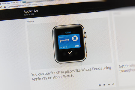 keynote: PARIS, FRANCE - MAR 9, 2015: Apple Computers event keynote tweets close up seen on iMac display with Apple Pay on Apple Watch transaction  as seen on 9 March, 2015