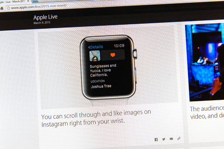 PARIS, FRANCE - MAR 9, 2015: Apple Computers event keynote tweets close up seen on iMac display with Instagram feed on Apple watch as seen on 9 March, 2015 Editorial