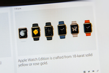 keynote: PARIS, FRANCE - MAR 9, 2015: Apple Computers event keynote tweets close up seen on iMac displayw with Apple watch Edition made from 18-karat solid yellow or rose gold as seen on 9 March, 2015 Editorial