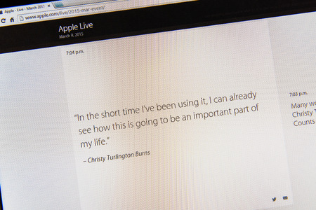 tweets: PARIS, FRANCE - MAR 9, 2015: Apple Computers event keynote tweets close up seen on iMac display with a quote from Christy Turlington Burns about how important Apple Watch is to her as seen on 9 March, 2015