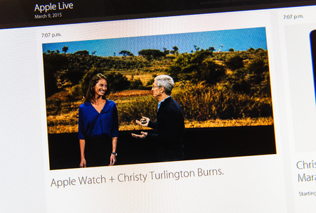 keynote: PARIS, FRANCE - MAR 9, 2015: Apple Computers event keynote tweets close up seen on iMac display with Christy Turlington Burn and Tim Cook talking about apple watchas seen on 9 March, 2015