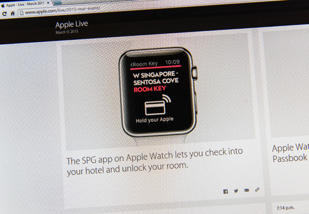 keynote: PARIS, FRANCE - MAR 9, 2015: Apple Computers event keynote tweets close up seen on iMac display with SPG app on Apple watch letting to check into hotel and unlock room as seen on 9 March, 2015