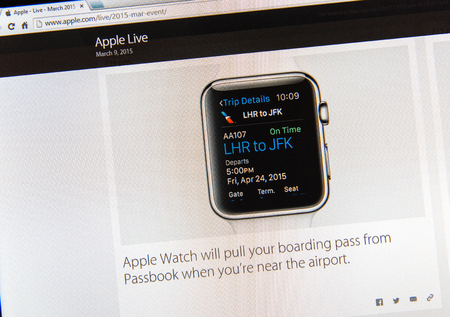 PARIS, FRANCE - MAR 9, 2015: Apple Computers event keynote tweets close up seen on iMac display with Apple Watch showing boarding pass from Passbook as seen on 9 March, 2015